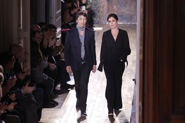 Italian designers Maria Grazia Chiuri and Pier Paolo Piccioli for Valentino appear at the end of their Haute Couture Spring-Summer 2011 fashion show in Paris