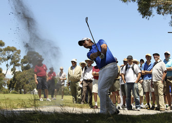 Matteo Manassero of Italy plays out of the rough on the 6th hole during the first round of the Australian Masters in Melbourne