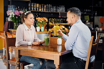 A man and a woman in a cafe.