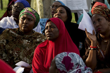 People attend a protest calling for the release of abducted schoolgirls from the remote town of Chibok in Abuja