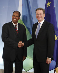 German Foreign Minister Westerwelle shakes hands with Djibouti Foreign Minister Youssouf at in Berlin