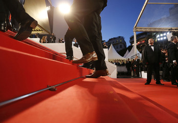 "Guests walks on the red carpet as they arrive at the festival Palace for the screening of the film ""Juste la fin du monde"" (It's Only the End of the World) in competition at the 69th Cannes Film Festival in Cannes"