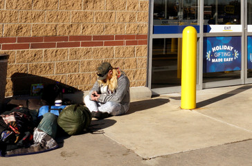 Angel (no last name given) waits for Black Friday sales to begin outside the Best Buy store in Westminster