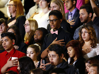 Students take the Pledge of Allegiance before U.S. President Obama gives a speech on his use of executive authority to relax U.S. immigration policy during a speech in Las Vegas, Nevada