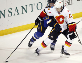 Blues' Pietrangelo and Flames' Backlund fight for the puck during the second period of their NHL hockey game in St. Louis
