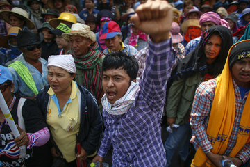 Farmer protesters gather during rally demanding the Yingluck administration resolve delays in payment, outside Government's temporary headquarters in Bangkok