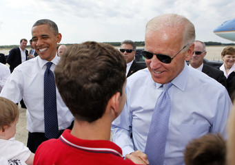 U.S. President Barack Obama and U.S. Vice President Joseph Biden shake hands after arriving in New Hampshire
