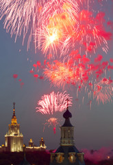 Fireworks explode in the sky above an Orthodox church with Moscow State University main building in the background during a display as part of celebrations for Victory Day in Moscow