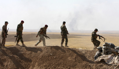 Kurdish peshmerga troops participate in an intensive security deployment against Islamic State militants on the front line in Khazir