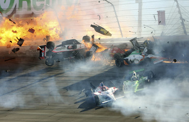 Race car of driver Power hits the wall along with drivers Hildebrand and Kimball during the IZOD IndyCar World Championship race at the Las Vegas Motor Speedway in Las Vegas