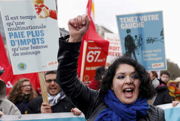 A protester chants slogans during a march in central Brussels