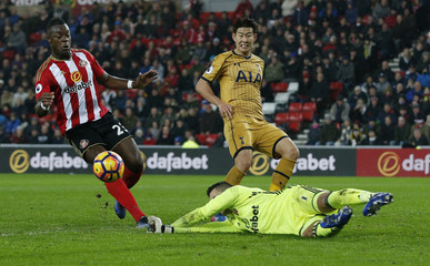Tottenham's Son Heung-min in action with Sunderland's Vito Mannone and Lamine Kone