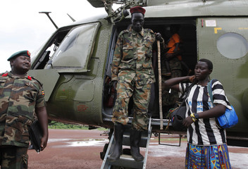 Lord's Resistance Army commander Caesar Achellam alights an army helicopter on arrival at the army operation base in Nera in South Sudan