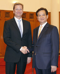 Germany's Foreign Minister Guido Westerwelle poses for a photo with Vietnam's Prime Minister Nguyen Tan Dung before their meeting at the Government Office in Hanoi
