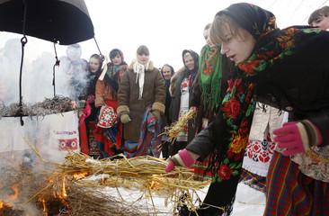 People celebrate Maslenitsa, or Pancake Week, in the village of Zakalnoye