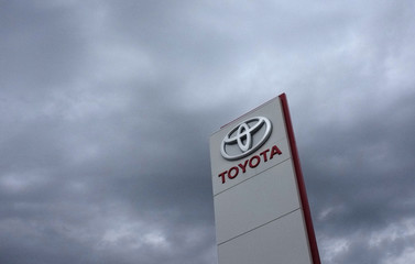 The Toyota logo is seen outside a Japan's Toyota Motor Corp car dealership in Tbilisi