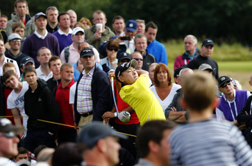 Yoshinori Fujimoto of Japan watches his tee shot during the second round of the British Open golf championship at Royal Lytham & St Annes