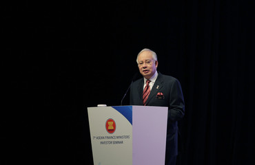 Malaysia's PM Razak delivers his keynote address during the ASEAN Finance Ministers' Investor Seminar in Kuala Lumpur