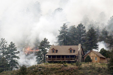 Flames erupt near a house in Colorado's High Park Fire, about 15 miles northwest of Fort Collins