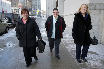 April Deboer and her partner Jayne Rowse, along with April's mother Wendy Deboer, walk to the U.S. District Court for closing arguments on their trial that could overturn Michigan's ban on same-sex marriage in Detroit