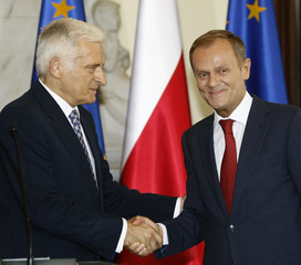 European Parliament President Buzek and Poland's PM Tusk shake hands during a news conference at the Prime Ministers Chancellery in Warsaw