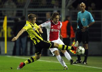Borussia Dortmund's Blaszczykowski challenges Ajax Amsterdam's Blind during their Champions League Group D soccer match in Dortmund