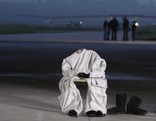 The suit and boots of Solar Impulse project CEO and pilot Andre Borschberg puts are pictured before take off at Payerne airport