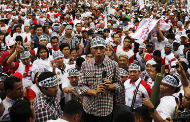 Indonesia's presidential candidate Joko Widodo talks to his supporters during a campaign rally in Jakarta