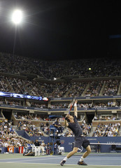 Murray of Britain serves during men's singles match at US Open  tennis tournament in New York