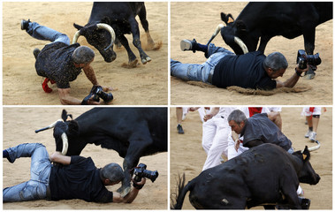 Combo pic of a photographer being knocked down by a wild cow during festivities in the bullring following the sixth running of the bulls of the San Fermin festival in Pamplona