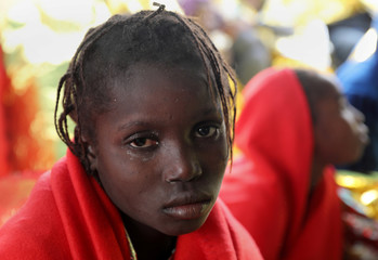 A migrant child is seen after she was rescued from an overcrowded raft, as lifeguards from the Spanish NGO Proactiva Open Arms rescue all 112 on aboard