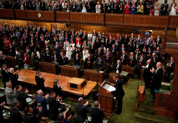 U.S. President Barack Obama acknowledges a standing ovation as he addresses Parliament in Ottawa