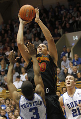 The University of Maryland's Williams goes to the basket against Duke University's Thornton and Plumlee during the second half of their NCAA basketball game in Durham