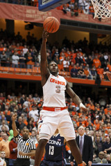Syracuse Orange guard Dion Waiters takes a shot during the second half of their NCAA men's basketball game against Connecticut Huskies in Syracuse, New York