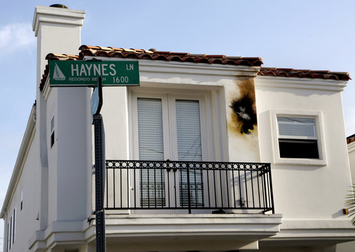 Burn mark is seen on the walls of a home that was hit by a lightning strike on Haynes Lane in a residential area of Redondo Beach