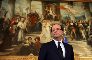 French President Francois Hollande listens to a speech at Dijon city hall