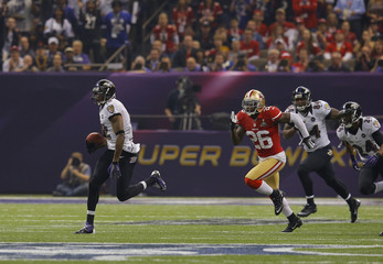 Baltimore Ravens' Jones runs back the second half kick-off for a 109 yard touchdown past San Francisco 49ers' Brock in the NFL Super Bowl XLVII football game in New Orleans