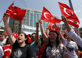 Protesters wave Turkish flags as they shout slogans against Kurdistan Workers Party during a demonstration in Istanbul