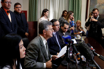 Henry Ramos Allup, president of the National Assembly and deputy of the MUD, talks to the media during a news conference at the National Assembly building in Caracas