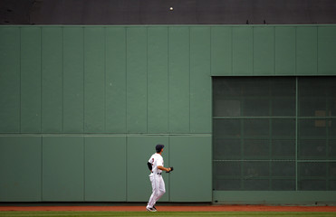 Boston Red Sox center fielder Ellsbury looks at Toronto Blue Jays' Lind's home run sitting in the covered seats in center field in the ninth inning of their MLB American League baseball game in Boston