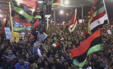 People gather during celebrations for the anniversary of the revolution of February 17 on the streets of the city of Benghazi