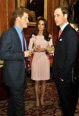 Britain's Prince William and his wife Catherine, Duchess of Cambridge speak to Prince Harry before a lunch for overseas royalty hosted by Queen Elizabeth at Windsor Castle in southern England
