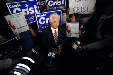 Independent U.S. Senate candidate and current Florida Governor, Charlie Crist, speaks to the media before entering his voting precinct to vote in Florida