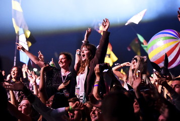 Revellers dance as they listen to Florence and the Machine perform on the Pyramid stage during the Glastonbury Festival at Worthy Farm in Somerset