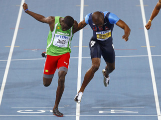 James lunges at the finish line to win the men's 400 metres final at the IAAF World Athletics Championships in Daegu