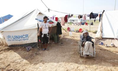A man who fled from Saadiya in Diyala province sits in a wheelchair in Ali Awa refugee camp, near Khanaqin