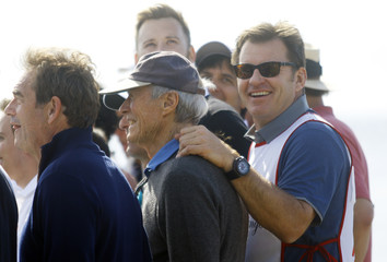 Clint Eastwood, Nick Faldo and Huey Lewis pose for a photo during the Celebrity Challenge charity event at the Pebble Beach National Pro-Am golf tournament