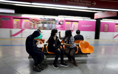 "Revellers apply make-up at a subway station before they attend the ""Zombie Walk"" parade in Sao Paulo, Brazil"