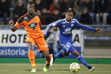 Lorient's Kone is challenged by Olympique Lyon's Njie during their French Ligue 1 soccer match at the Moustoir stadium in Lorient