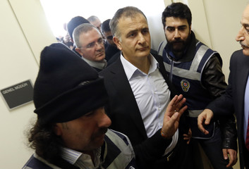 Zaman editor-in-chief Dumanli is escorted by plainclothes police officers as he leaves from his office at the headquarters of Zaman daily newspaper in Istanbul December 14, 2014.